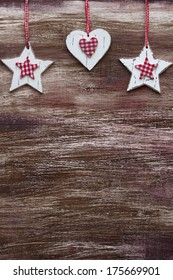 Shabby chic wooden shapes on rustic background