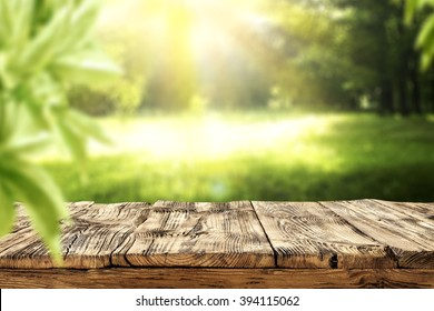 shabby deck and green garden background and sun light
