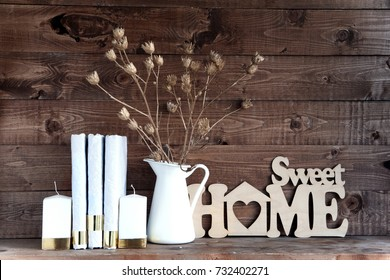 Shabby old interior decor for farmhouse. dried flowers in pots book,candle on a vintage shelf over wood wall. Home decoration.