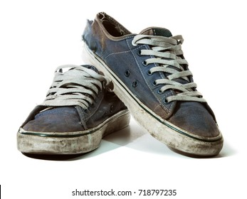 shabby, ragged, dirty old blue shoes isolated on white background