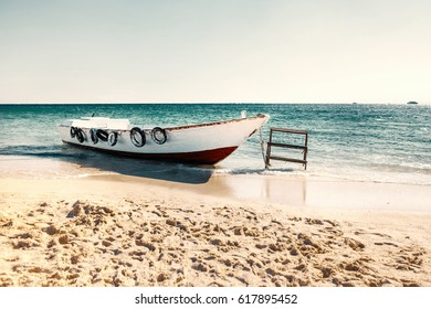 shabby vintage boat on the beach