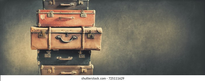 Shabby Vintage Stacked Ancient Suitcases Travel Concept Brown Luggage Background Banner