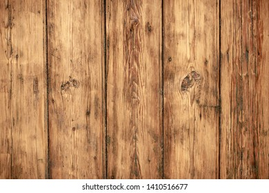Shabby wooden wall background. Texture of obsolete carpentry wooden boards, panel. Vintage dirty wood floor. Old wooden plank grunge texture. Weathered oaky fence, oaken table, timber. Hardwood brown