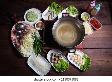 Shabu Shabu, a popular dish of pork, beef, shrimp, squid, seafood and fresh vegetables. Placed on a table with a boiling pot boiling.