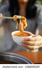 Shabu Shabu thai style tomyum soup with spicy sauce.