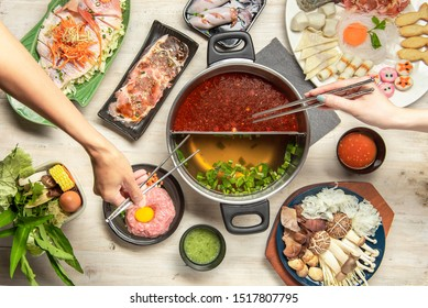 Shabu-shabu is a Japanese nabemono hotpot dish of thinly sliced meat and vegetables boiled in water. The term is onomatopoeic, derived from the sound emitted when the ingredients are stirred - Shutterstock ID 1517807795