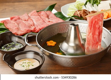 shabu-shabu, thin slices of beef parboiled in hot soup
