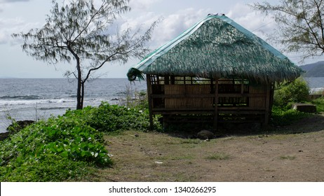 Shack made of bamboo and grass by the sea on a hot tropical summer.