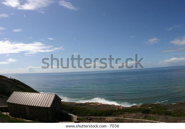 shack near the ocean waves