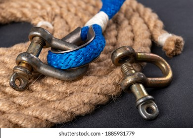 Shackle and rope on the table. Accessories for sea wolves on the table. Dark background.