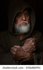 shackled old man with middle ages time