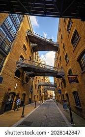 Shad Thames, London, UK - Aug 11 2021: Historic Shad Thames in London near Tower Bridge. This old cobbled street is known for its overhead walkways. Bridges of Shad Thames, Bermondsey, London, UK.