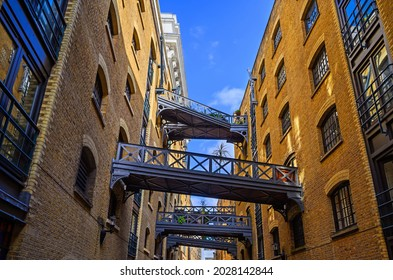 Shad Thames in London, UK. Historic Shad Thames is an old cobbled street known for its restored overhead bridges and walkways. This old street is in Bermondsey near Tower Bridge and London Bridge.