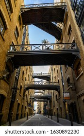 Shad Thames, London / UK - Jan 29 2020: Historic Shad Thames in London near Tower Bridge. This old cobbled street is known for it's overhead walkways. Bridges of Shad Thames, Bermondsey, London, UK.