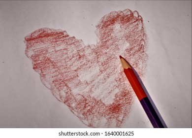 shaded red heart sketched with a red pencil on white paper