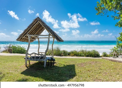 A shaded resting place with a thatched roof along Diani Beach