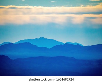 shades of blue mountains in distance
