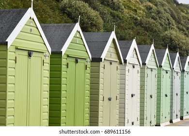 Shades of green and grey. Different Color Beach Huts by the seadisde.