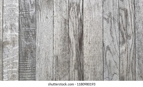 Shades of grey wood textured backdrop with clear graphic wooden pattern. Old weathered wooden plank wall in shades of grey. Rustic wood texture. Wooden background. Wood surface closeup.