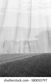 Shades of light through the curtain with motion blur of pleasant wind (black and white tone)