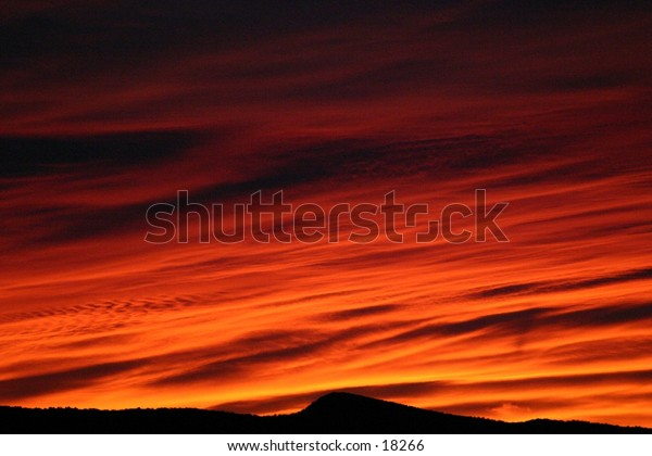 Shades of orange and yellow distinguish a late winter sunrise in southern Colorado