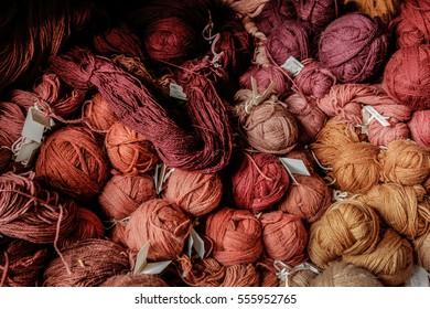 Shades of red woolen yarn balls