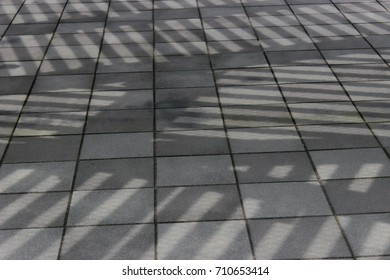 Shading of city. Walkable environment. Shadow of bus station. Abstract pattern. Japanese urban. Japanese architecture.