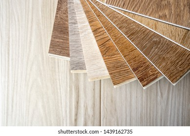 Shading color of wooden vinyl sheet sample stack on wood plank ceramic tiles space