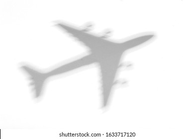 Shadow of an airplane on a white background.
