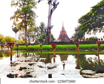 The shadow of the ancient pagoda and reflection of the decoration in the water with the Loy Krathong Festival in Sukhothai Historical Park.