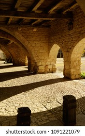 "Shadow and arches play in Montpazier, french bastide town, member of ""Les Plus Beaux Villages de France"" association."