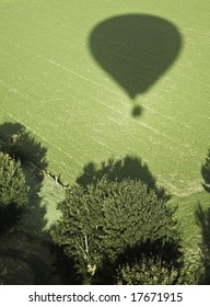 Shadow of an balloon passing over a field
