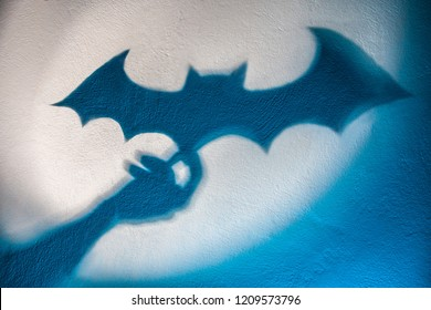 Shadow of a bat on the wall. Halloween. Batman. Concept.