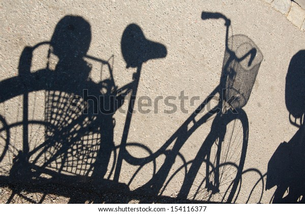 Shadow of a bicycle on the asphalt