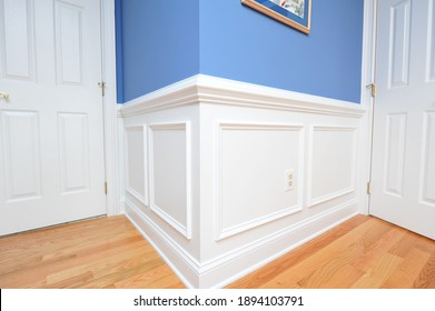 Shadow boxes, wainscoting painted bright white with hardwood floor