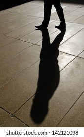 Shadow of businessman walk in the street.