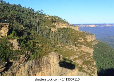 The Shadow of a Cable Car on a Cliff at Katoomba, in Australia's Blue Mountains