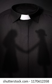 shadow of children on the priest's cassock background