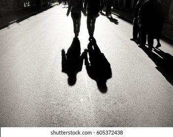 Shadow of couple on asphalt walking with holding hands concept of relationship