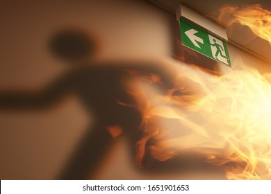 the shadow of an escaping man and a fire in the building