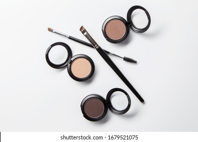 Shadow for the eyebrows, brown eye shadow, eyebrows, eyebrow brush, isolated on white background