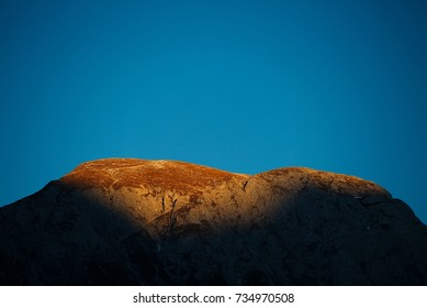 Shadow falling on a mountain range on a sunset