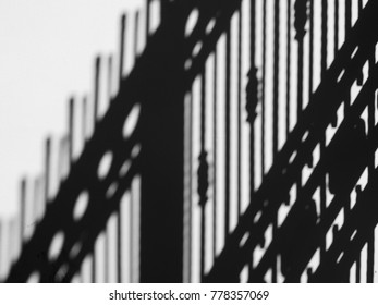 shadow of fence on wall black and white style