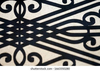 shadow from a forged lattice on the ground