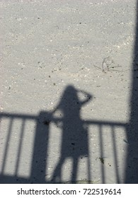 Shadow of a Girl and a Railing