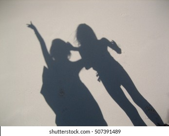 Shadow of girls on a white sand beach in Punta Cana, Dominican Republic