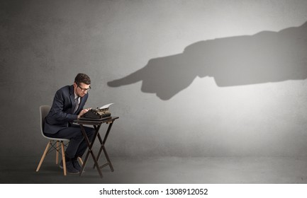 Shadow hand pointing at a small afraid worker