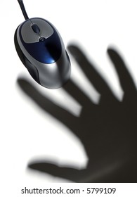 Shadow of a human hand over a computer mouse