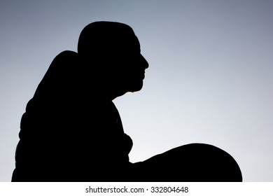 shadow image of monk in Thailand