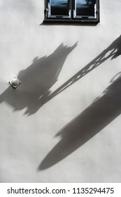 Shadow of the lantern on the wall